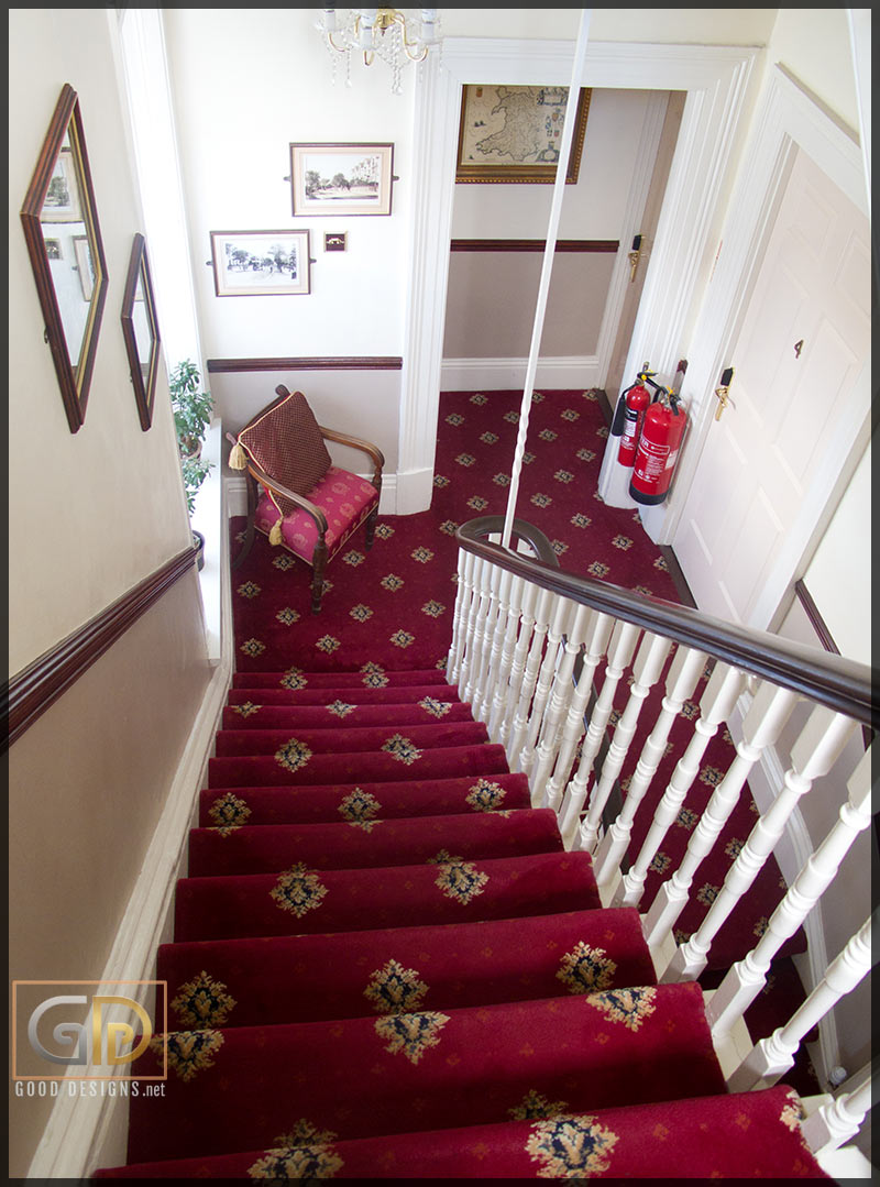 Red carpeted stairs